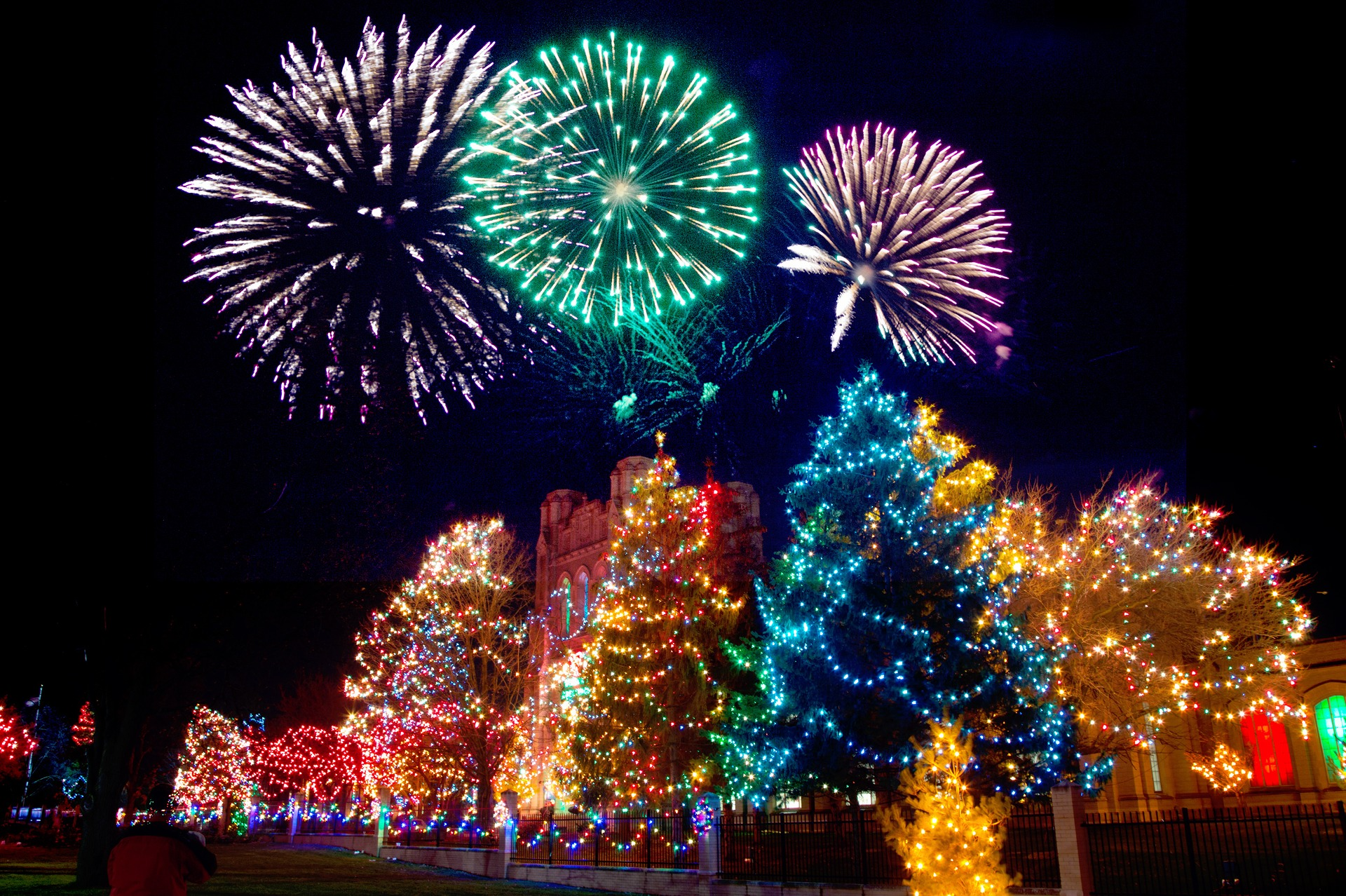Xmas trees lit up & fireworks in sky