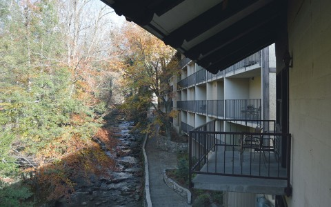 Exterior view of property balconies facing river & trees