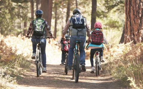 Group riding bikes on trail