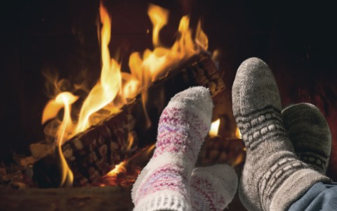 close up of feet by the fireplace