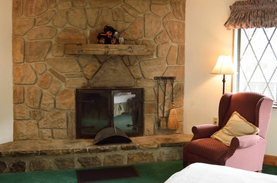 Stone built fireplace with chair