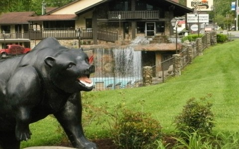 Close up of bear sculpture at property entrance