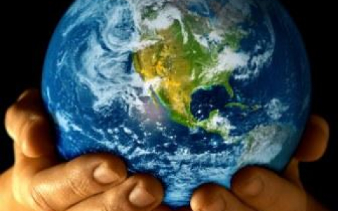 Photo of the Earth Held in Two Hands for Earth Day