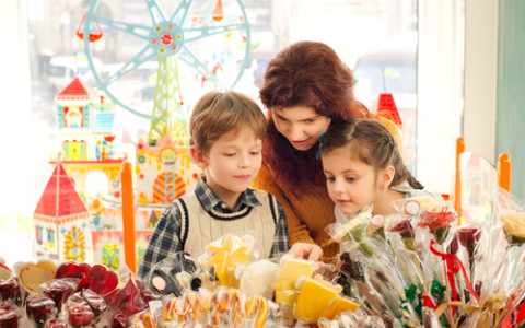 mom and kids in candy shop