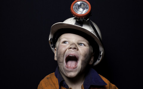 little boy dresses as a miner