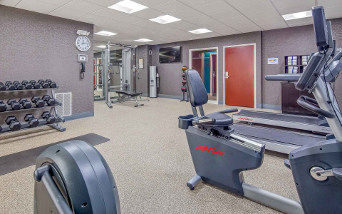 Fitness center with machines & rack with dumbbells