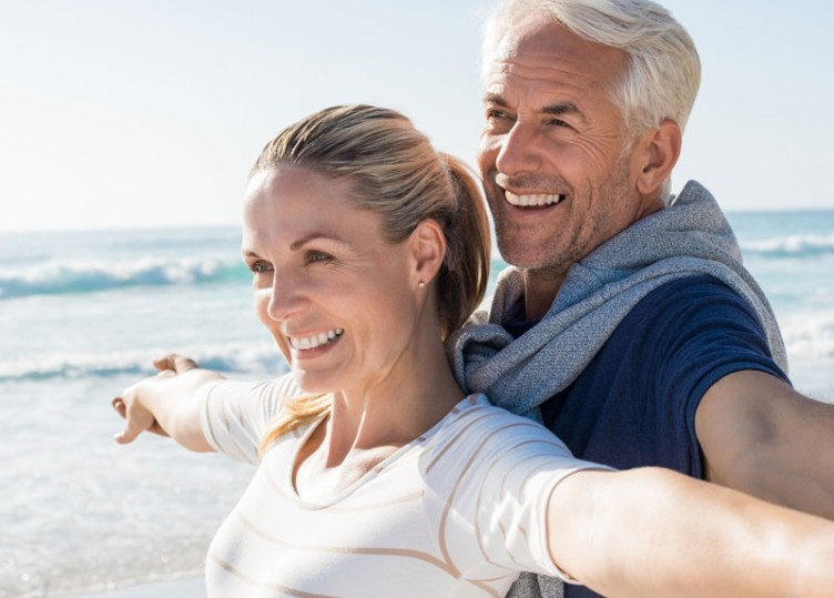 Cheerful mature couple on the beach