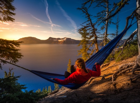 woman relaxing in hammock crater lake oregon