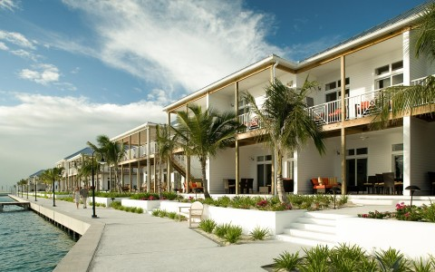 Property villas with balconies & porches facing ocean harbor