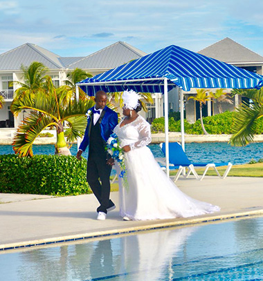 couple having wedding poolside
