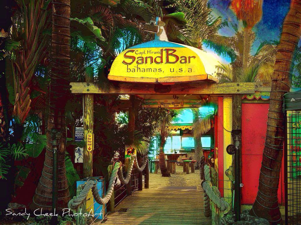 the sand bar front entrance and yellow awning