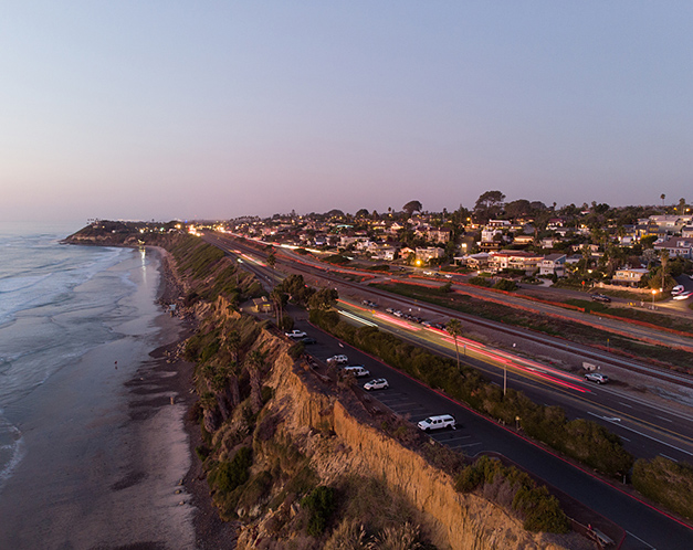 aerial view of beach, shoreline and road