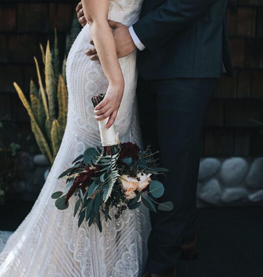 close up of a bride and groom holding each other close