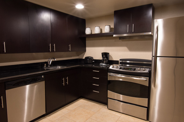 full kitchen with silver appliances and dark brown cabinets