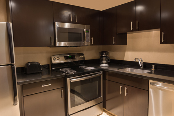 full kitchen with silver appliances and brown cabinets