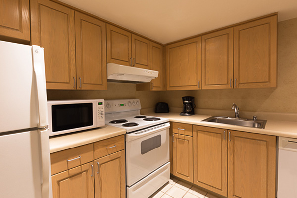 Full kitchen with white appliances and wooden cabinets