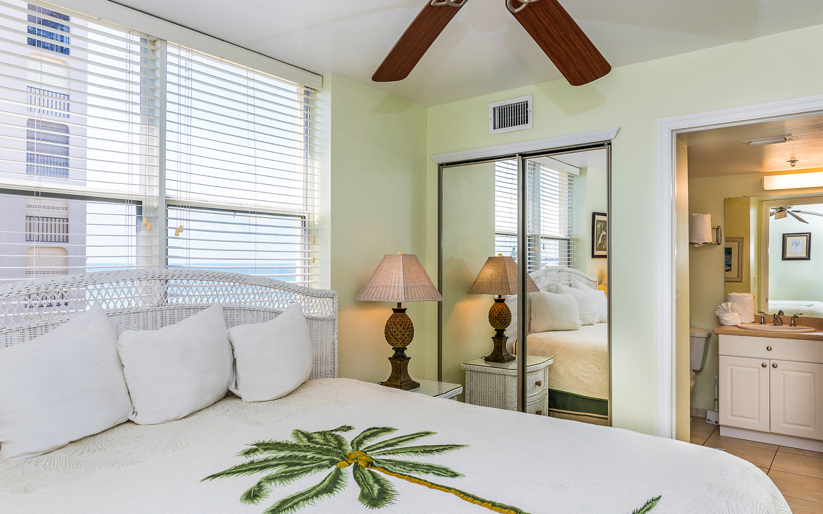 Casa Play Resort Gulfview Studio bed with palm frond bedspread