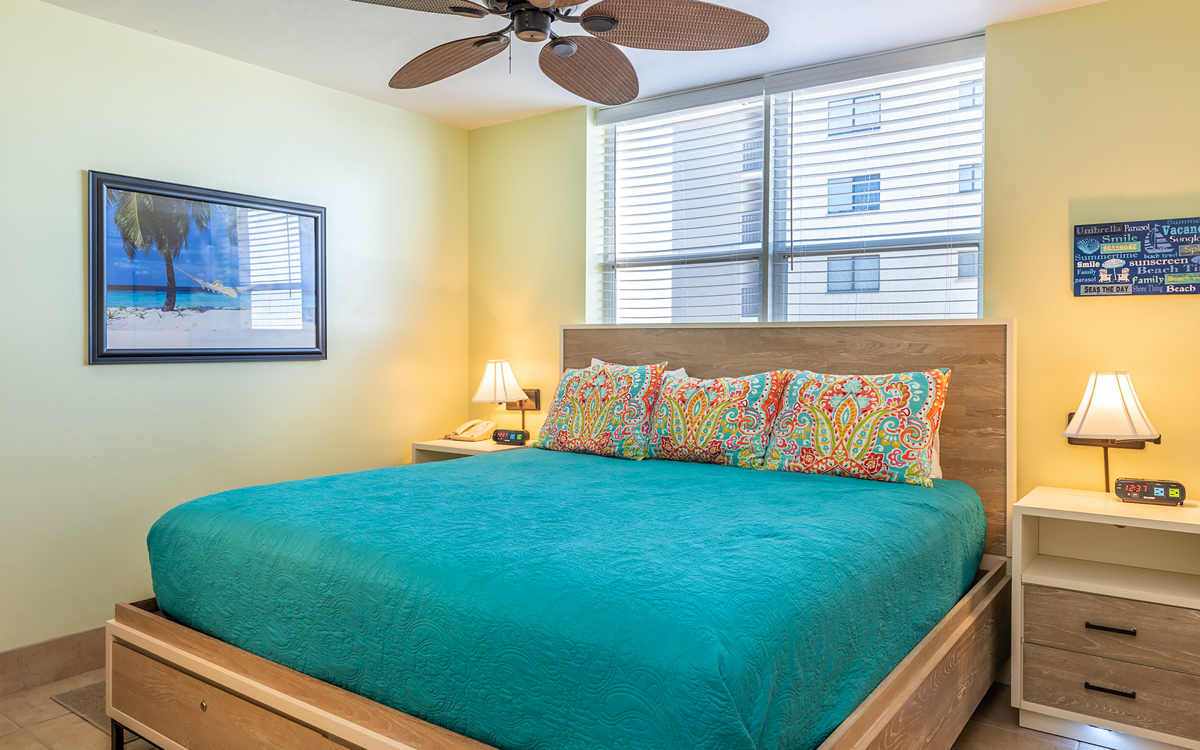 Casa Play Resort Gulfview Suite bedroom with turquoise bed spread