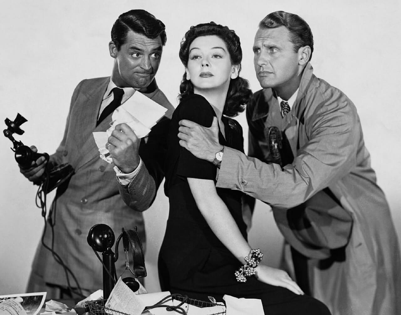 Black and white photo of Hollywood stars Cary Grant Rosalind Russell and Ralph Bellamy