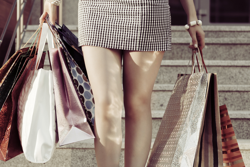 woman shopping holding several shopping bags
