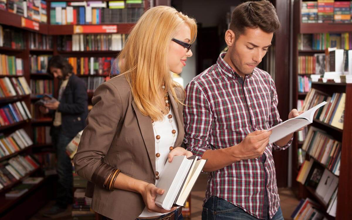 man and woman in book store looking at books