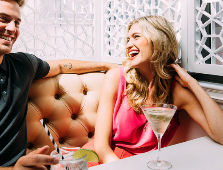 couple laughing over cocktails at fits-1