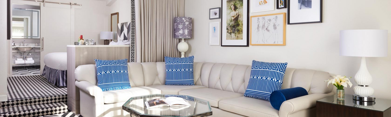 guest room sitting area with white leather sofa