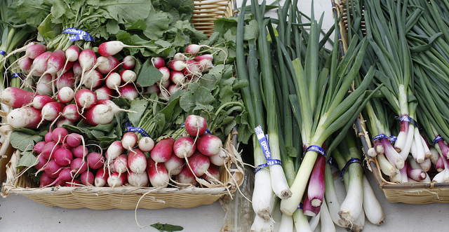 Baskets of Radishes and Leeks at a Farmers Market