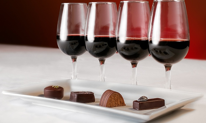 Glasses of Red Wine with Elegant Chocolate Truffles