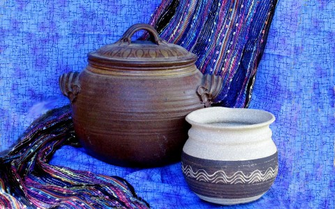 Pottery & Multicolored Scarf on Blue Background