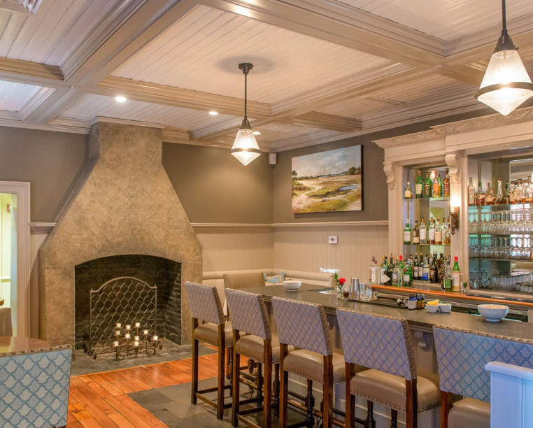 Charming Inns Circa 1886 bar area and fireplace