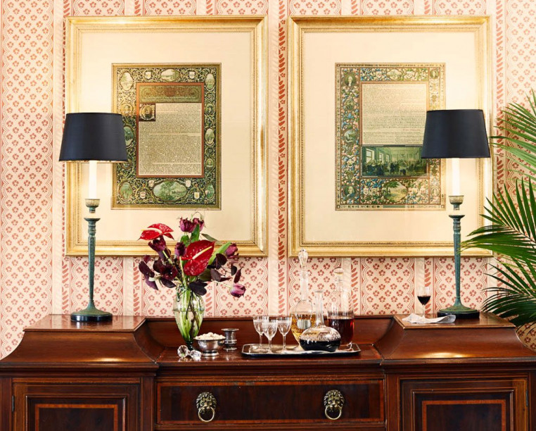 Charming Inns John Rutledge House wooden writing desk with two frames and a printed wall paper