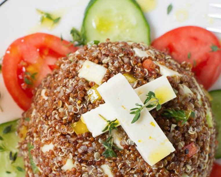 quinoa salad with feta and tomatoes on a plate