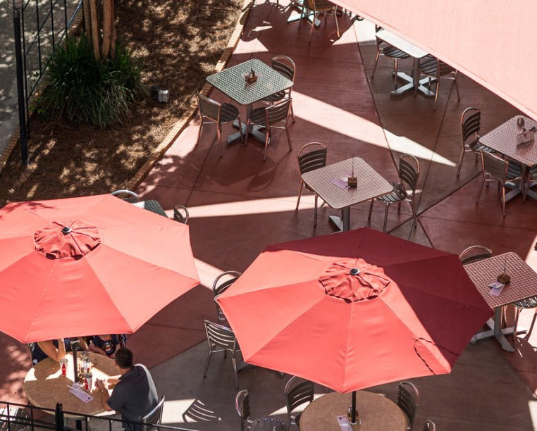 red umbrellas with metal tables