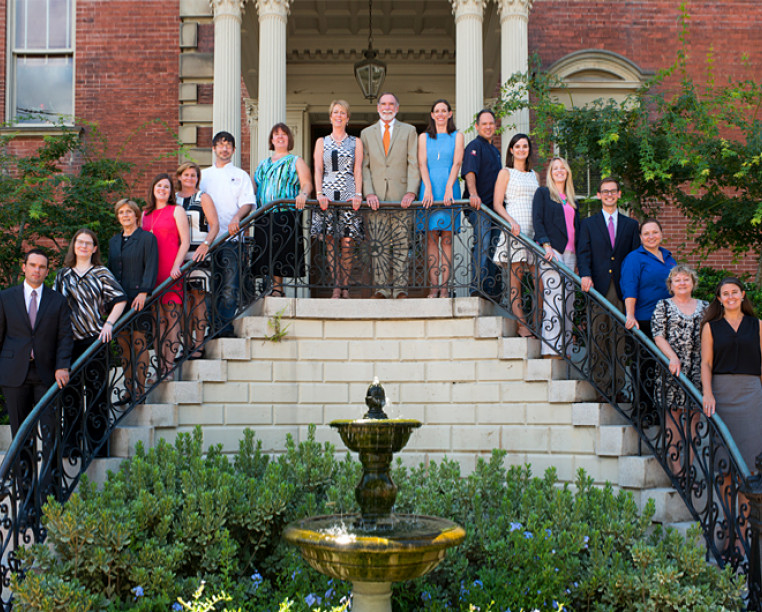 Charming Inns team lined up on the doorsteps of the wentworth mansion staircase