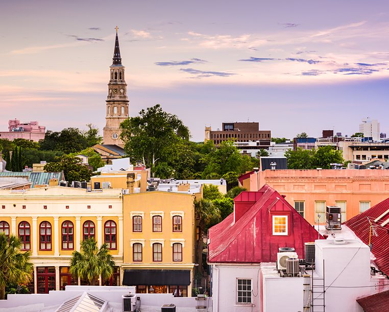 skyline of charleston and a sunset with colorful homes