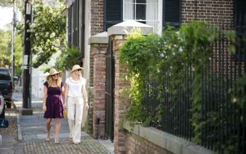 two woman walking in Charleston streets