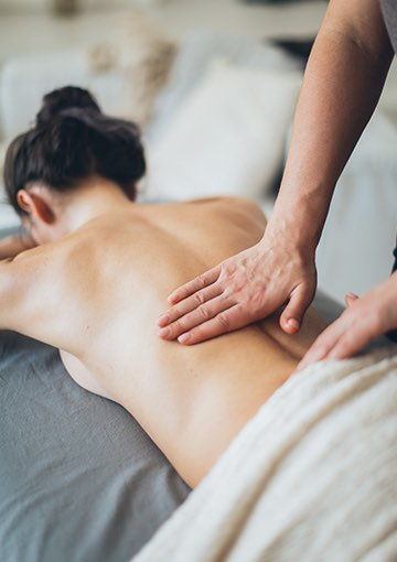 guest receiving a massage on their back