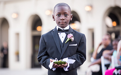little boy ring bearer walking down the aisle