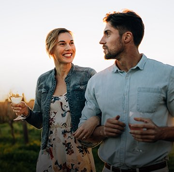 couple walking through a wine tour