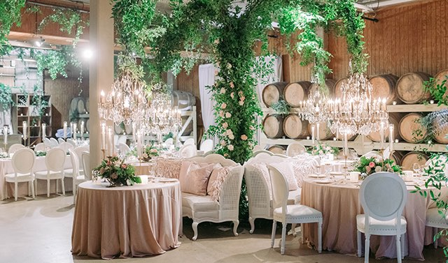 wedding venue with a lounge area decorated with greenery