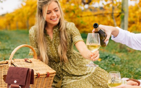 woman sitting and getting more wine