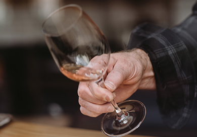 person holding a wine glass on a tilt