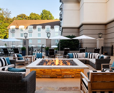 fire pit by the pool surrounded with seating