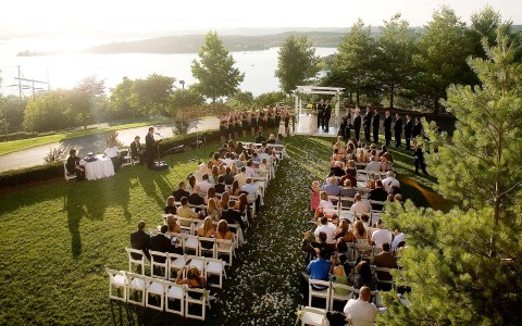 Outdoor wedding w/ bride & groom at altar