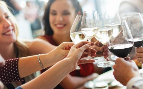 Group of people toasting with wine