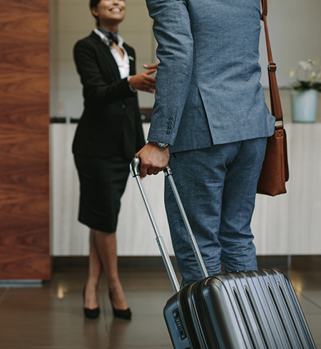Man arriving to hotel with suitcase