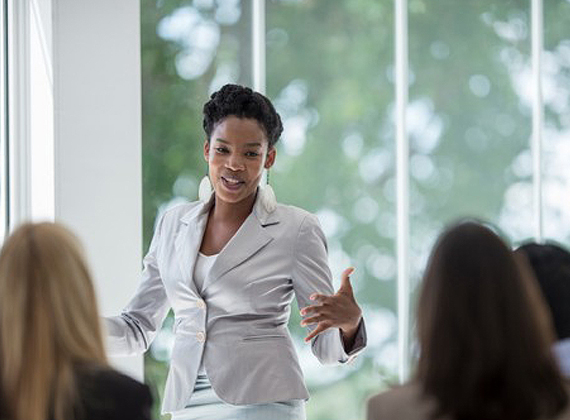 a woman talking during a meeting