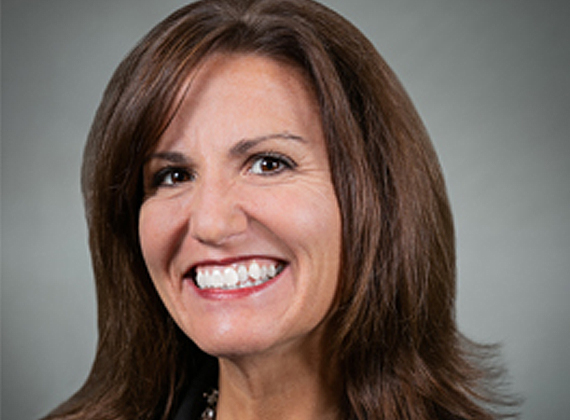 a woman's headshot for business