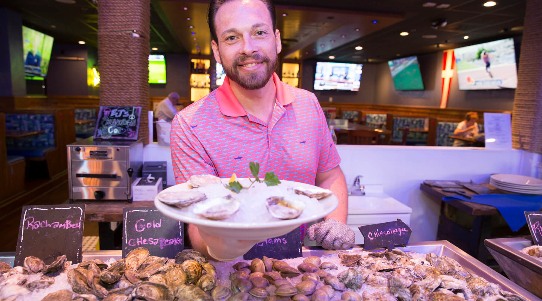 a man serving oysters